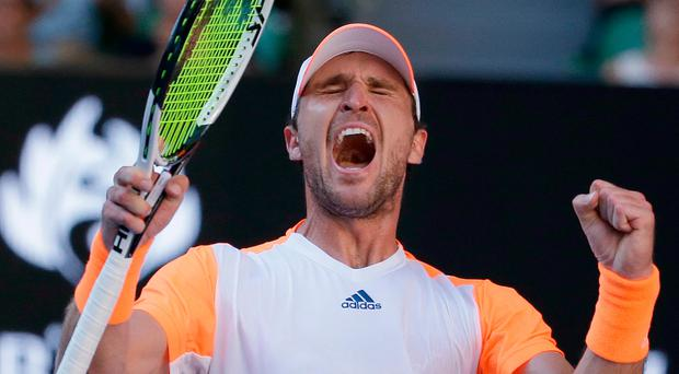 Germany's Mischa Zverev celebrates after defeating Britain's Andy Murray in their fourth round match at the Australian Open. Photo: Aaron Favila/AP