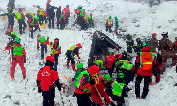 Rescuers dig out the snow-covered Rigopiano hotel in the hope of finding survivors. Photo: AP