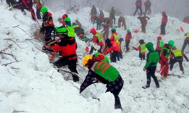 Rescuers work in the area of the avalanche-hit Rigopiano hotel, central Italy. Photo: AP