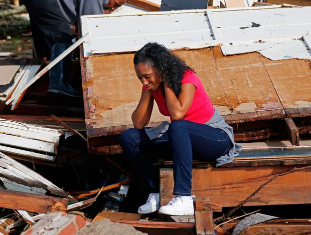Shanise McMorris cries at the remains of her home in Hattiesburg, Mississippi. Image: AP Photo/Rogelio V. Solis