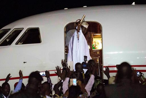 Gambia's defeated leader Yahya Jammeh waves to supporters as he departs from Banjul airport (AP Photo/Jerome Delay)