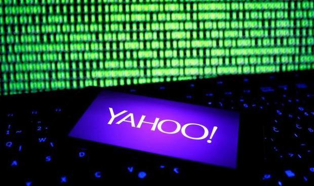 A photo illustration shows a Yahoo logo on a smartphone in front of a displayed cyber code and keyboard. REUTERS/Dado Ruvic/File Illustration