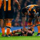 Hull City's Ryan Mason lies injured after head clash