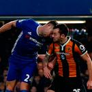Chelsea's Gary Cahill (L) and Hull City's Ryan Mason clash heads