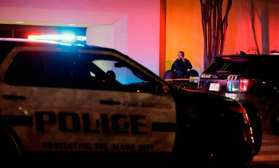 San Antonio police stand guard at an exit to the Rolling Oaks Mall after a deadly shooting Sunday, Jan. 22, 2017, in San Antonio. (AP Photo/Eric Gay)
