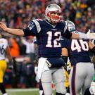 New England Patriots quarterback Tom Brady (12) reacts after a touchdown