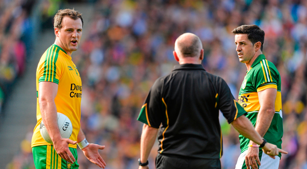 Michael Murphy, Donegal, speaks to umpire Marty Duffy with Kerry's Aidan O'Mahony in 2014