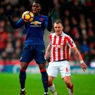 Stoke City's Glenn Whelan (right) and Manchester United's Paul Pogba battle for the ball at the weekend