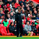 Liverpool manager Jurgen Klopp looks dejected on the touchline during the defeat to Swansea