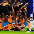 Ryan Mason of Hull City lies injured after the collision with Gary Cahill