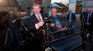 Enda Kenny with Eamon Creamer, owner of a 1916 Ford Model T, in Ballymahon, Co Longford, yesterday. Photo: Mark Condren