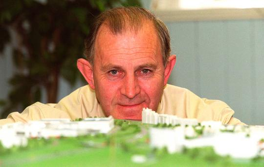 Mr O'Callaghan with a model of his Mahon Point project.