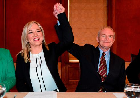 Michelle O'Neill is congratulated by Martin McGuinness as she is unveiled as the new Sinn Féin leader in the North at a Stormont press conference. Photo: Charles McQuillan/Getty Images