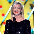 Presenter Olivia Newton-John speaks onstage during the American Country Awards 2013 at the Mandalay Bay Events Center on December 10, 2013 in Las Vegas, Nevada. (Photo by Ethan Miller/Getty Images)