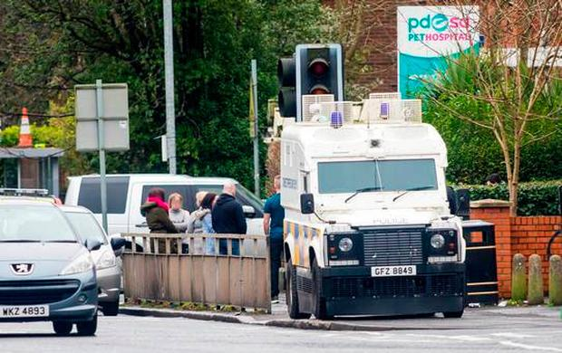 Police at the scene of the death. (Photo - Kevin Scott / Belfast Telegraph)