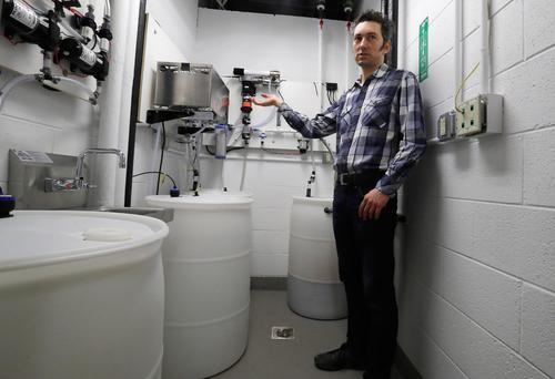 Abe Noe-Hays, director of research at the Vermont-based Rich Earth Institute describes the filtration system he helped develop to turn urine into fertilizer at the University of Michigan engineering building (Photo: AP Photo/Carlos Osorio)