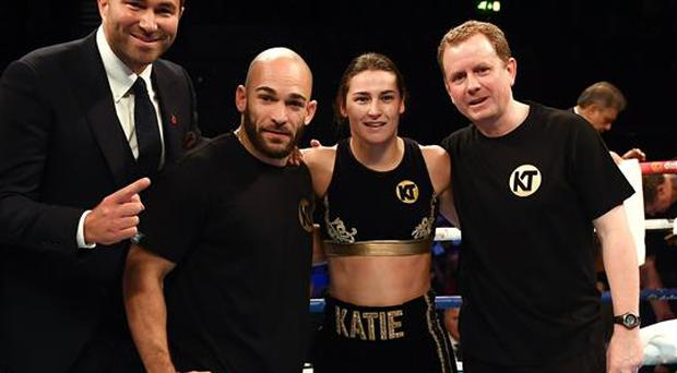 26 November 2016; Katie Taylor with promoter Eddie Hearn, left, trainer Ross Enamait and manager Brian Peters, right, following her Super-Featherweight fight with Karina Kopinska at Wembley Arena in London, England. Photo by Stephen McCarthy/Sportsfile