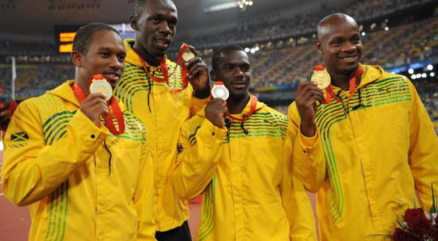 Jamaica's Michael Frater, Asafa Powell, Nesta Carter and Usain Bolt pose with their gold medals during the medal ceremony for the men's 4x100m relay at the National stadium as part of the 2008 Beijing Olympic Games on August 23, 2008.