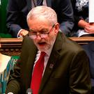 Jeremy Corbyn (C) speaks during the weekly Prime Minister's Questions session in the House of Commons in central London. Photo: /AFP/Getty Images