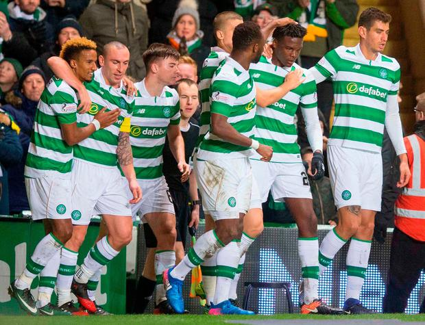 Celtic's Dedryck Boyata (second right) celebrates scoring his side's winning goal during the Ladbrokes Scottish Premiership match at Celtic Park