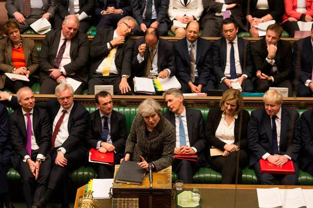 Theresa May during Prime Minister's Questions in the House of Commons yesterday, where she was quizzed on Brexit. Photo: PA