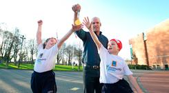 Roisín Mulcahy (8) and Dillon Madigan (8), from Limerick, joined Paul O'Connell to launch Aldi's sponsorship of the Community Games Picture: Brian Gavin