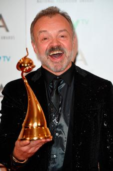 Graham Norton with the Special Recognition Award. Photo by Anthony Harvey/Getty Images