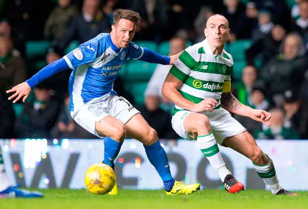 St Johnstone's Chris Millar and Celtic's Scott Brown battle for the ball. Photo: PA