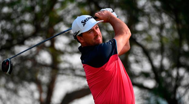 Graeme McDowell of Northern Ireland hits his tee shot on the 18th hole during the first round of the Commercial Bank Qatar Masters at the Doha Golf Club