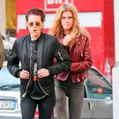 Kristen Stewart lands at Milan Airport with Victoria's Secret model Stella Maxwell. Picture: XPOSUREPHOTOS.COM