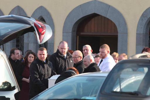The coffin is carried from St John the Baptist Church in Kilberry, Co Meath, after the funeral of Daniel O'Keeffe. Photo: Collins