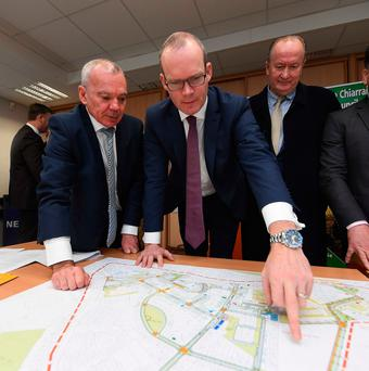 Mike Scannell of Kerry County Council , Simon Coveney T.D., Minister for Housing and Cllr Jim Finucane look at the plans for 15 new homes in Tralee as part of the Government's Rebuilding Ireland Action Plan for Housing and Homelessness. Photo: Domnick Walsh