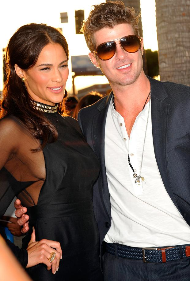 Cast member Paula Patton arrives with her husband musician Robin Thicke for the Los Angeles premiere of