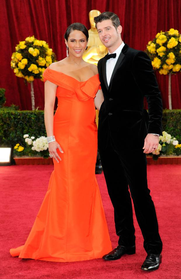 Actress Paula Patton arrives with her husband singer Robin Thicke at the 82nd Annual Academy Awards held at Kodak Theatre on March 7, 2010 in Hollywood, California. (Photo by Frazer Harrison/Getty Images)
