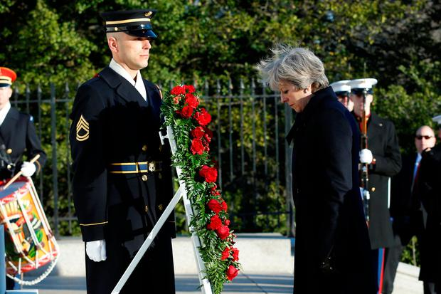 British Prime Minister Theresa May bows her head as she lays a wreath at the Tomb of the Unknown Soldier at Arlington National Cemetery in Washington, U.S., January 27 2017. REUTERS/Yuri Gripas