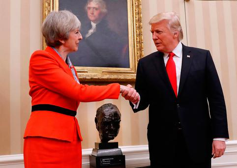 President Donald Trump shakes hands with British Prime Minister Theresa May in the Oval Office of the White House in Washington, Friday, Jan. 27, 2017. (AP Photo/Pablo Martinez Monsivais)