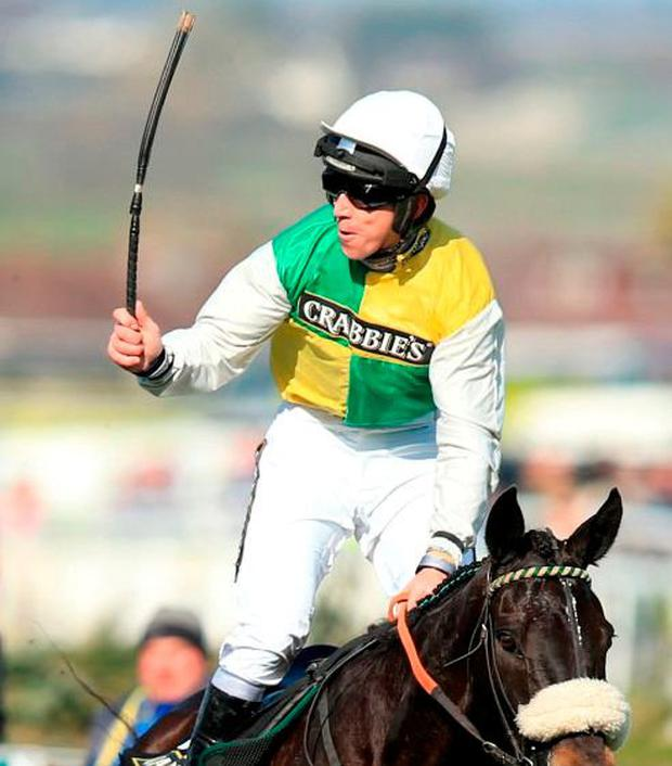 Jockey Leighton Aspell celebrates on board Many Clouds after victory in the Crabbie's Grand National Chase in 2015. Photo: Mike Egerton/PA Wire