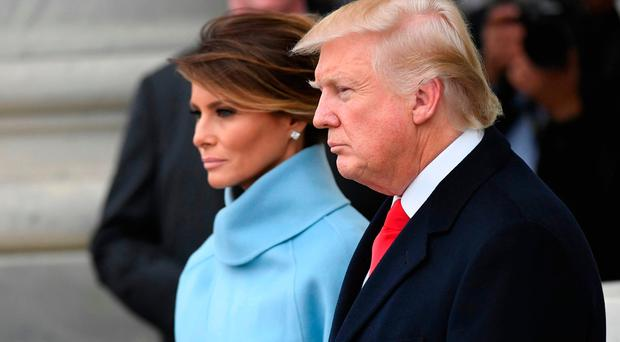 President Trump, here with current wife Melania in Washington last week, is determined to build walls and Ireland's defence in the upcoming Six Nations will have to be even as solid as a rock. Photo: AP