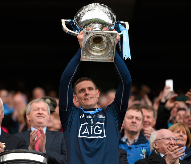 Stephen Cluxton lifts the Allianz NFL Division 1 trophy. Photo: Sportsfile