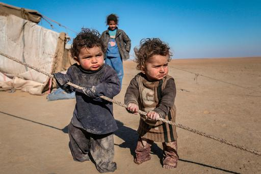 Internally displaced Syrian children who fled Raqqa city stand near their tent in Ras al-Ain province, Syria. Photo: Reuters