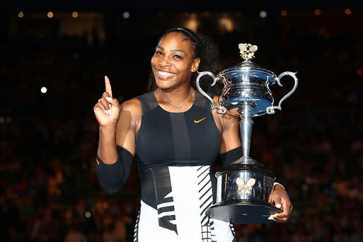 MELBOURNE, AUSTRALIA - JANUARY 28: Serena Williams poses with the Daphne Akhurst Trophy after winning the Women's Singles Final against Venus Williams of the United States on day 13 of the 2017 Australian Open at Melbourne Park on January 28, 2017 in Melbourne, Australia. (Photo by Clive Brunskill/Getty Images)