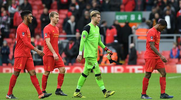 Liverpool's German goalkeeper Loris Karius (2R) leave the pitch following the English FA Cup fourth round football match between Liverpool and Wolverhampton Wanderers at Anfield in Liverpool, north west England on January 28, 2017. Wolverhampton won the match 2-1. / AFP / Paul ELLIS