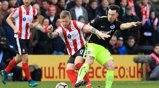 Lincoln City's Irish midfielder Alan Power (L) vies with Brighton's Irish midfielder Richie Towell during the English FA Cup fourth round football match between Lincoln City and Brighton & Hove Albion at the Sincil Bank stadium in Lincoln, eastern England, on January 28, 2017.