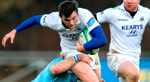 UCD's Jeremy Loughman tackles Ned Hodson of Cork Con during the Ulster Bank League game. Photo: Gary Carr/INPHO