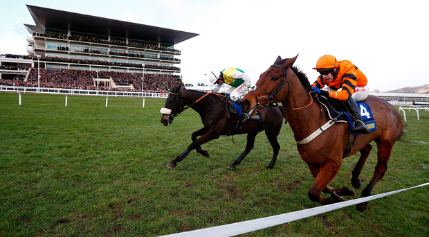 Leighton Aspell riding Many Clouds (left) battles back to win the Cotswold Chase from Thistlecrack at Cheltenham before collapsingalmost. Photo: Alan Crowhurst/Getty Images