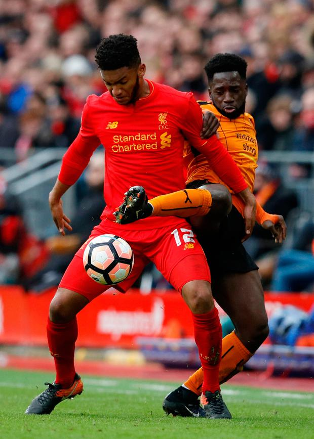 Liverpool's Joe Gomez in action with Wolves' Nouha Dicko. Photo: Phil Noble/Reuters