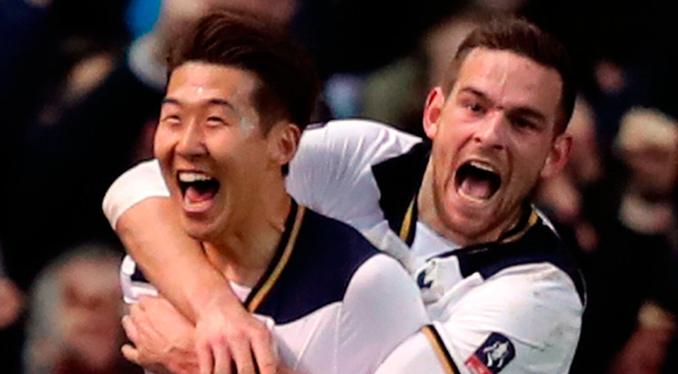 Tottenham Hotspur's Son Heung-Min (left) celebrates scoring his side's fourth goal of the game with Vincent Janssen. Photo: Andrew Matthews/PA