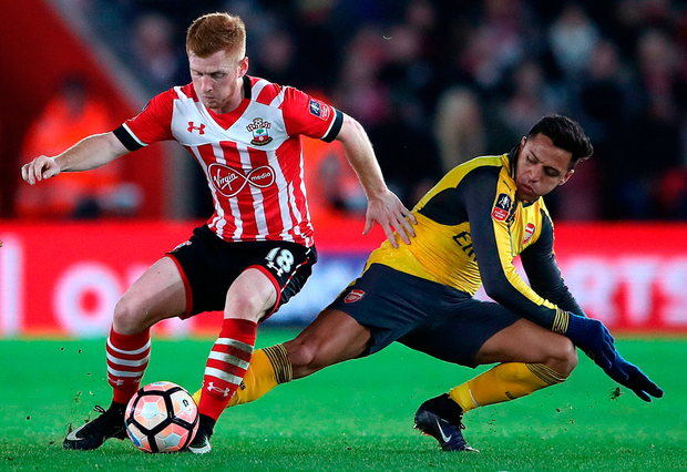 Southampton's Harrison Reed (left) and Arsenal's Alexis Sanchez during the Emirates FA Cup, fourth round match at St Mary's Stadium. Photo: Nick Potts/PA