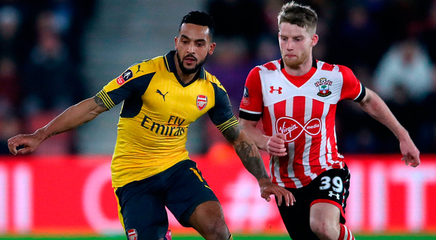 Arsenal's Theo Walcott (left) and Southampton's Josh Sims battle for the ball during the Emirates FA Cup, fourth round match. Photo: Nick Potts/PA