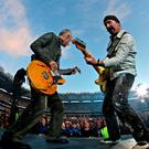 Adam Clayton (left) and The Edge from U2 playing at Croke Park in Dublin in 2008 Photo: Julien Behal/PA Wire
